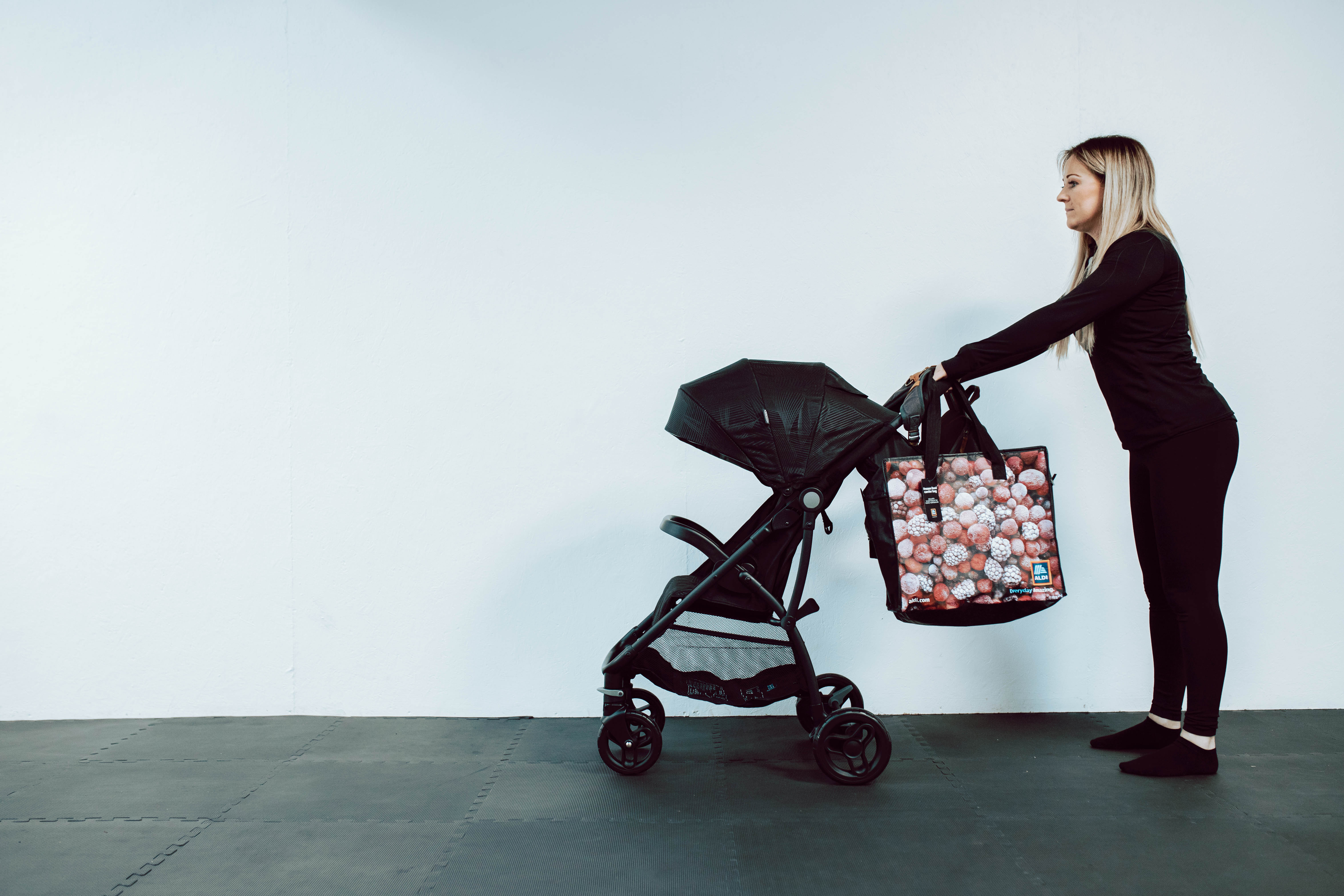 Mother with bad pushchair posture